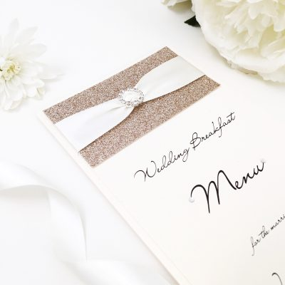 Classic Ivory and Gold Glitter Menu with satin ribbon and a diamante buckle