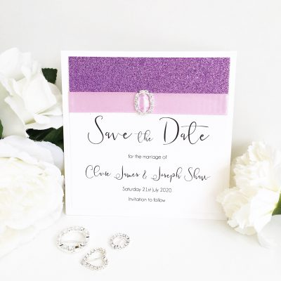 Lilac & Purple Glittery Save the Dates with a fancy oval diamante buckle