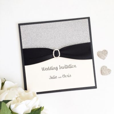Black & Silver Glitter Folded Wedding Invitation with an Oval Diamante Buckle