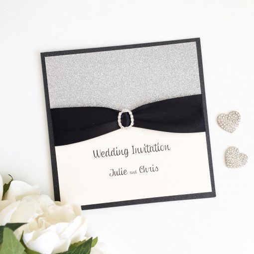 Black & Silver Glitter Folded Wedding Invitation with an Oval Diamante Buckle
