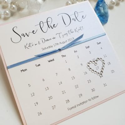 Calendar Theme Save the Date with a blush pink and baby blue colour scheme