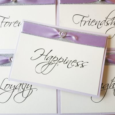 Lilac and Silver Glitter themed Table Name signs with a fancy diamante embellishment