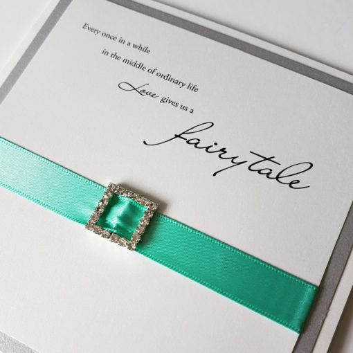 Love Gives you a Fairytale themed Wedding Invitations with a fancy diamante buckle