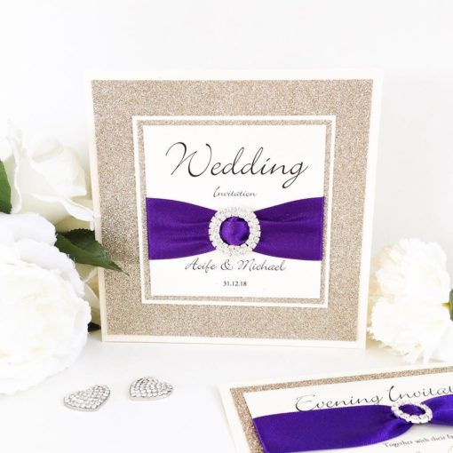 Luxury Purple and Gold Glitter Wedding Invitations with a large fancy diamante buckle