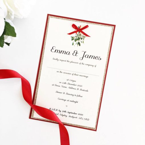 Mistletoe themed Winter Wedding Invitations with a red bow detail.