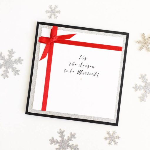Silver Glitter and Red Christmas Present themed Wedding Invitation with a bow detail