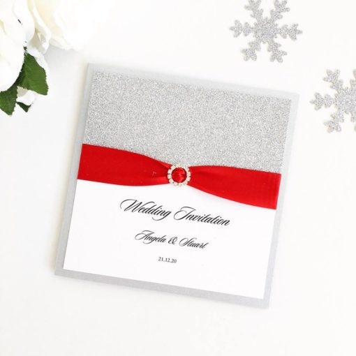 Silver Glitter themed Wedding Invitations with red ribbon and a fancy diamante buckle