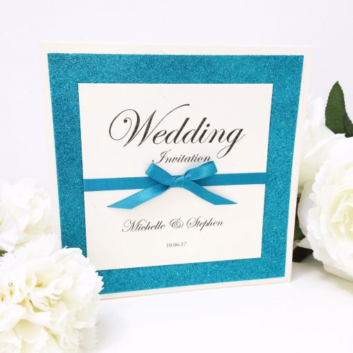 Teal Glitter folded wedding invitation with a bow detail