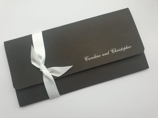 Classic Matt Black and White Wallet with a Ribbon Bow detail and Foiled wording on the cover