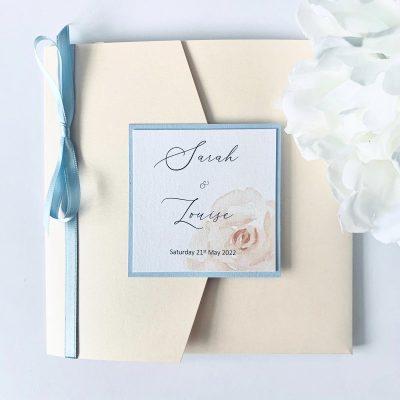 Peach and powder blue pocketfold invitation