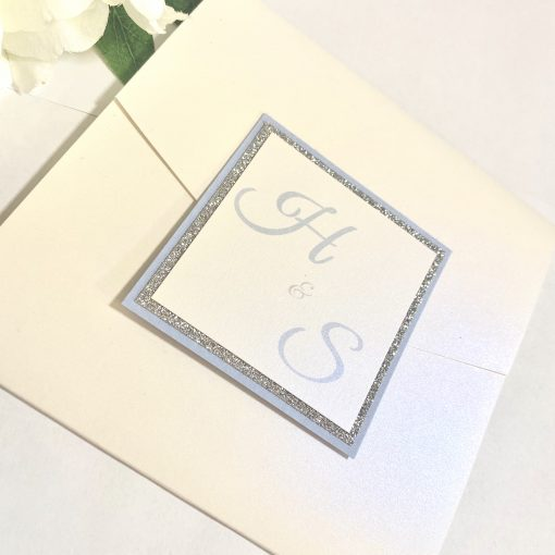 Crisp white pocketfold invitation with initials