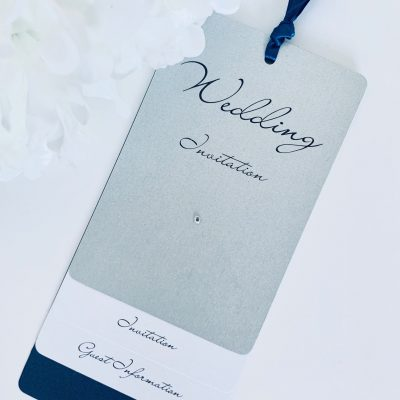 Navy and silver luggage tag style invitation
