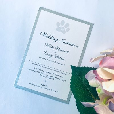 Paw print invitation with silver border