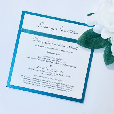 Square invitation with teal border and matching ribbon