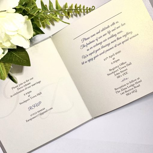 folded invitation with silver glitter and buckle