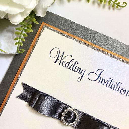 grey pocketfold invitation with dior bow and buckle