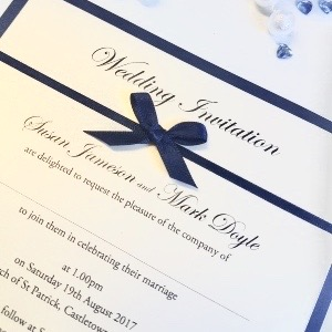 Navy and Ivory Wedding Invitation with bow and pearl detail