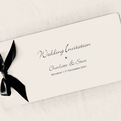 ivory cheque book with black bow