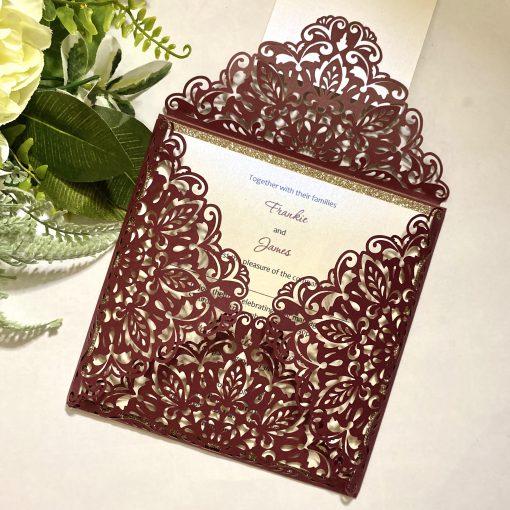 burgundy laser cut envelope invitation with plaque