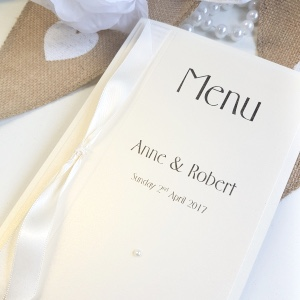 Traditional Ivory pearlised Wedding Breakfast Menu with knotted ribbon