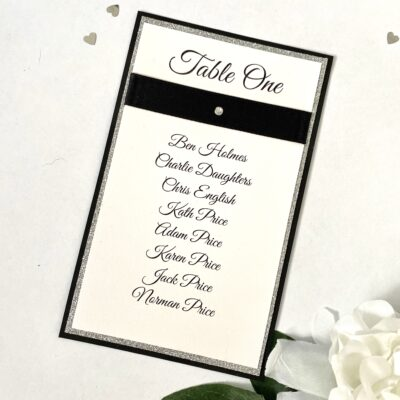 black and silver table name with buckle