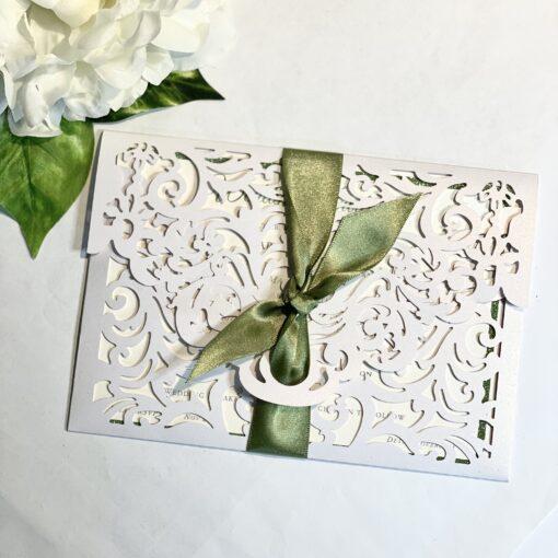 green glitter laser cut invitation