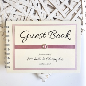 Guest book with pink ribbon and buckle